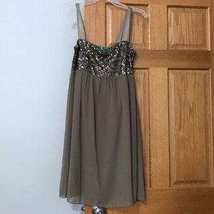Brown sequins knee length dress.